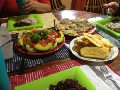 Lunch at my house one day. In the upper right-hand corner, there's Pescozon de Chayote filled with cheese and fried on the outside. Ensalada to the left and platanos to the right. And of course, rice and beans on each of our plates.