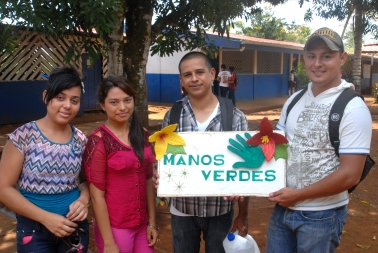 José's group, Manos Verdes (Green Hands), holding up their sign at the secondary school in La Esperanza.