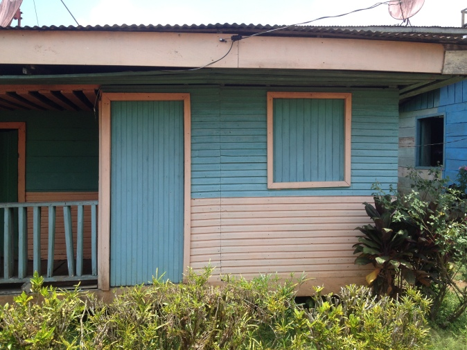 Most of the houses are made of wood and are painted colorfully like this one.