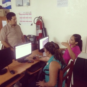 Obed, the professor I've been working with at URACCAN, assisting one of his IT students as we taught the fundamentals of how to use Open Street Map on Saturday, May 16.