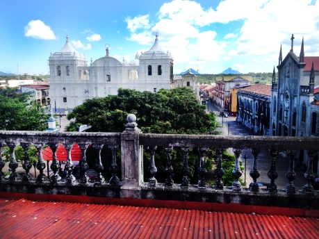 Rooftop view of Leon's cathedral, the largest in Central America. On the horizon, volcanoes Momotombo and Momotombito.